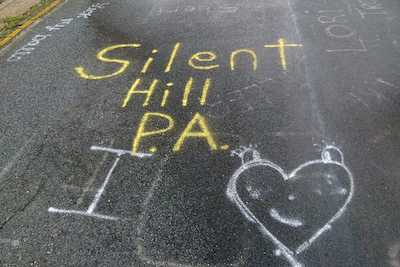 Graffiti on a road with the words Silent Hill.