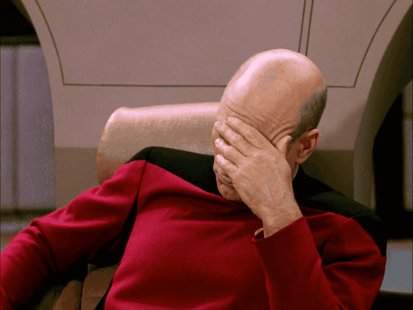 Captain Jean-Luc Picard from Star Trek TNG facepalming